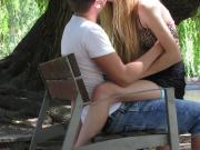 Lovely young pair making out on a bench