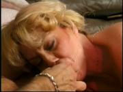 Round-ass MILF gobbles young stud on sofa