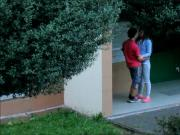 Beautiful teen couple kissing cuddling and caressing outside