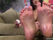 Gabriella Paltrova jerks off a black cock with her feet