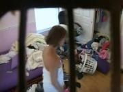 Hidden cam captures hot milf in unkempt bedroom