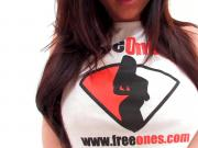 Kendall Karson teases the camera in her FreeOnes shirt