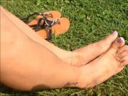 My Sext feet in the grass
