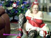 Mature Sally under the Xmas tree