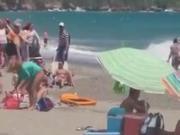 Girl caught masturbating on the beach