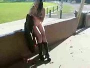 Young wife flashing at the park and plays with toy