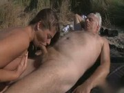 Romantic BJ for Oldie on the beach
