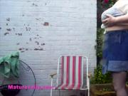 Sally getting her massive tits soaking wet outdoors