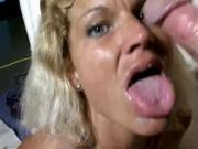 Tanned blond MILF slut squeezing cum from a dick