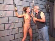 Nicole in bondage gets spanked against brick wall