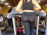 Turkish girl in shiny transparent black leggings