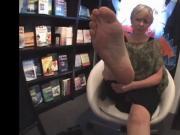 Older woman showing feet