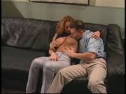 Big breasted redhead with a tight snatch is fucked on black leather couch