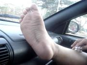 Relaxing foot on the dash and singing