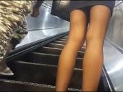 Metro girl in shiny black bantyhose