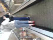 Escalator Milf in blue jeans short hair!