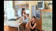 Young Couple Cook Dinner In The Kitchen