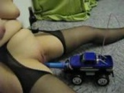 Privatvideo - german woman playing with a dildo and a car