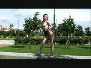 Young girl shows her body in the park