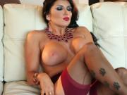 Busty brunette Romi Rain toys her wet pussy