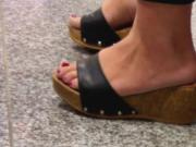 Public feet and shoeplay with red toes