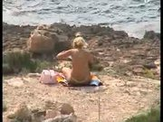 Couple have sex on the beach