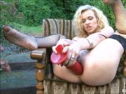 Blonde using big red dildo on both her holes
