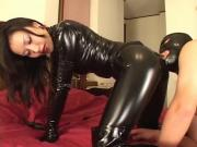 Mistress Reiko in sexy catsuit with her slave