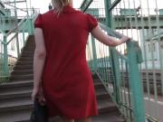 Girl in stockings and red dress going upstairs