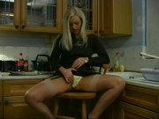 British girl Rachel plays with herself in the kitchen