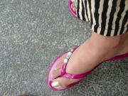 Candid feet at bus stop