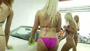 girls play at the car wash