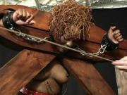 Masochistic black female enjoys bondage