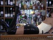 Uniform latex babe Olivias fetishwear and long rubber boots