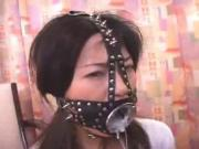 Asain giving a gagging blowjob using O-Ring