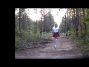 School girl walk out in the woods