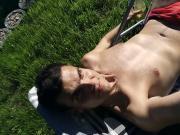 guy and his wet body in red speedo