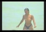 Spycam - beach - topless girl