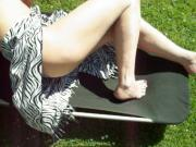 mature legs and feet sunbathing