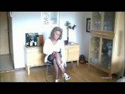 Mature lady in stockings & suspenders