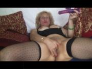 Blonde Mature Lady in Black Designed Stockings