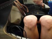 Bare legged upskirt on train