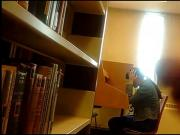 college teen Asian library flashing