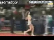 Cheerleader removes her top during a basketball game