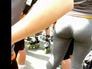 a woman in leggings with big round butt