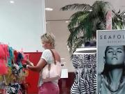 Follow woman in pink shorts