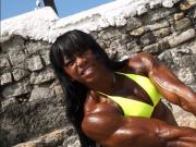 black brazilian female bodybuilder flexing big muscles