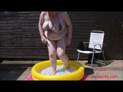 by the pool in a tiny bikini