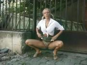 Blond slag pissing outside 3