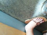 Candid of friend's feet in restaurant